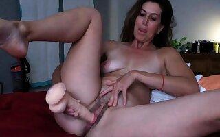 Big boob brunette masturbates first of all webcam